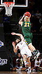 SIOUX FALLS, SD - MARCH 6:  A.J. Jacobson #21 of North Dakota State shoots a layup over defender Evan Hall #24 of IUPUI in the 2016 Summit League Tournament.  (Photo by Dave Eggen/Inertia)