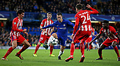 5th December 2017, Stamford Bridge, London, England; UEFA Champions League football, Chelsea versus Atletico Madrid; Eden Hazard of Chelsea on the ball while being marked by Jose Gimenez , Stefan Savic and Thomas Partey of Atletico Madrid