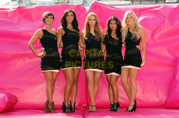 THE SATURDAYS - Frankie Sandford, Rochelle Wiseman, Una Healy,Vanessa White & Mollie King .Photocall to launch the T-Mobile Big Sofa/Night In campaign, London, England. .June 2nd, 2010.full length black one shoulder dress brown boots sheer hand on hip.CAP/CAS.©Bob Cass/Capital Pictures.