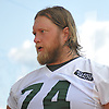 Nick Mangold #74, New York Jets center, speaks with a reporter after a day of team training camp at Atlantic Health Jets Training Center in Florham Park, NJ on Friday, July 29, 2016.