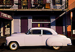 Classic 1950's Chevrolet is parked in front of the Funky Butt nightclub in the French Quarter of New Orleans