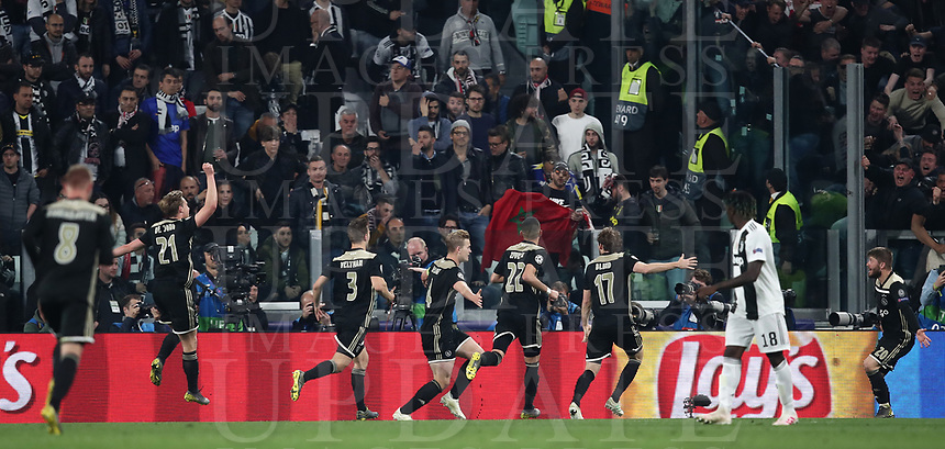 Football Soccer: UEFA Champions UEFA Champions League quarter final second leg Juventus - Ajax, Allianz Stadium, Turin, Italy, March 12, 2019. <br /> Ajax's captain Matthijs de Ligt (c) celebrates after scoring with his teammates during the Uefa Champions League football match between Juventus and Ajax  at the Allianz Stadium, on March 12, 2019.<br /> UPDATE IMAGES PRESS/Isabella Bonotto