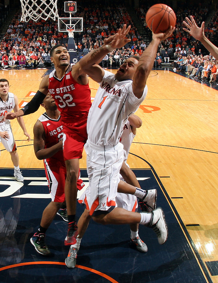 Virginia guard Justin Anderson (1) shoots next to North Carolina State forward Kyle Washington (32) during the game Wednesday Jan. 7, 2015 in Charlottesville, Va. Virginia won 61-51.