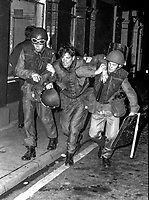 Injured soldier helped away by colleagues during clashes with rioters in the Bogside are of Londonderry, N Ireland, UK. September 1969, 196909000347..Copyright Image from Larry Doherty, c/o Victor Patterson, 54 Dorchester Park, Belfast, UK, BT9 6RJ..Tel: +44 28 9066 1296.Mob: +44 7802 353836.Voicemail +44 20 8816 7153.Skype: victorpattersonbelfast.Email: victorpatterson@mac.com.Email: victorpatterson@ireland.com (back-up)..IMPORTANT: If you wish to use this image or any other of my images please go to www.victorpatterson.com and click on the Terms & Conditions. Then contact me by email or phone with the reference number(s) of the image(s) concerned.
