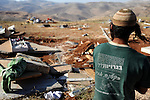 A young settler amidst ruins, after Israeli police completed demolishing the unauthorized Israeli outpost of Ma'oz Ester.