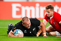 1st November 2019, Tokyo, Japan;  (L to R) Joe Moody (NZL) is tackled on the try line by Hallam Amos (WAL);  2019 Rugby World Cup 3rd place match between New Zealand 40-17 Wales at Tokyo Stadium in Tokyo, Japan.  - Editorial Use