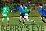 Mathew Naughton, Killorglin takes the ball from Stephen Lyons and Jason O'Sullivan, Killarney Celtic in Killorglin on Saturday morning.