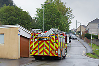 A fire engine remains on standby after a fire in Kilvey Hill, above house in the Saint Thomas area of Swansea, Wales, UK. Friday 17 May 2019