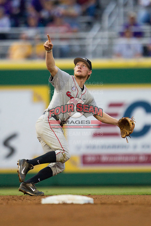 Georgia Bulldogs shortstop Nelson Ward #2 tracks a pop fly during the Southeastern Conference baseball game against the LSU Tigers on March 22, 2014 at Alex Box Stadium in Baton Rouge, La. The Tigers defeated the Bulldogs 2-1. (Andrew Woolley/Four Seam Images)