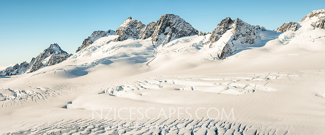 Mountain ranges of Southern Alps with Explorer Glacier crevasses in upper parts of Fox Glacier NEVE, Westland Tai Poutini National Park, West Coast, UNESCO World Heritage Area, New Zealand, NZ