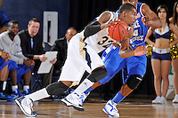 12 January 2012:  FIU guard Jeremy Allen (32) drives to the basket around Middle Tennessee guard-forward Kerry Hammonds (24) in the first half as the Middle Tennessee State University Blue Raiders defeated the FIU Golden Panthers, 70-59, at the U.S. Century Bank Arena in Miami, Florida.