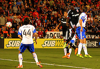 WASHINGTON, D.C - May 17 2014: Eddie Johnson  watches his shot go for a goal, his first for United during D.C. United vs the Montreal Impact MLS match at RFK Stadium, in Washington D.C. The game ended in a 1-1 tie.