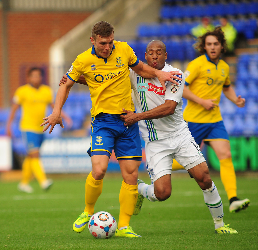 Lincoln City's Jack Muldoon vies for possession with Tranmere Rovers' Matthew Hill<br /> <br /> Photographer Andrew Vaughan/CameraSport<br /> <br /> Football - The FA Cup Fourth Qualifying Round - Tranmere Rovers v Lincoln City - Saturday 24th October 2015 - Prenton Park - Birkenhead<br /> <br /> &copy; CameraSport - 43 Linden Ave. Countesthorpe. Leicester. England. LE8 5PG - Tel: +44 (0) 116 277 4147 - admin@camerasport.com - www.camerasport.com