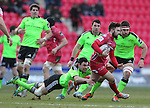 Munster fullback Felix Jones dives to tackle his opposite number Jordan Williams.<br /> Guiness Pro12<br /> Scarlets v Munster<br /> 21.02.15<br /> ©Steve Pope -SPORTINGWALES
