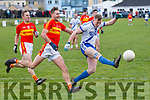 St Marys Captain Denis Daly in action eluding a challenge from Valentia's John Curran and adds another point for the home side.
