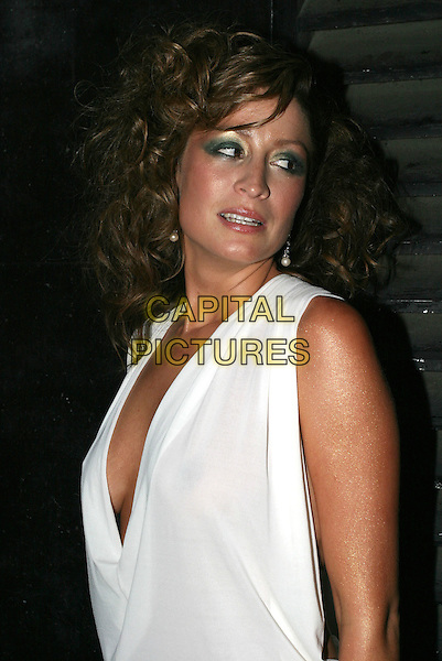 "REBECCA LOOS.Attends ""Christmas in July "" Fashion Show and Party, Pangaea, London,.13th July 2004..half length white top low cut plunging neckline curly hair green eye shadow make up golden skin shimmery bronzed.Ref: AH.www.capitalpictures.com.sales@capitalpictures.com.©Capital Pictures."