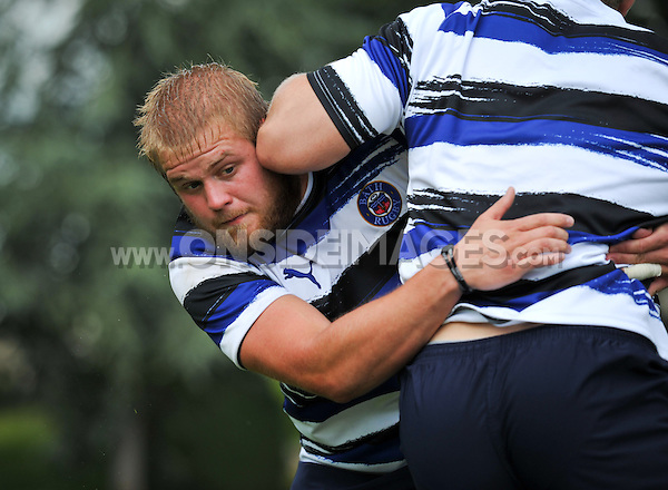 Mark Lilley puts in a tackle. Bath Rugby training session on August 2, 2011 at Farleigh House in Bath, England. Photo by: Patrick Khachfe/Onside Images