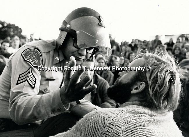 Santa Barbara Police talk with sit-in demonstrator, 1960's demonstration, demonstration against war in Vietnam,
