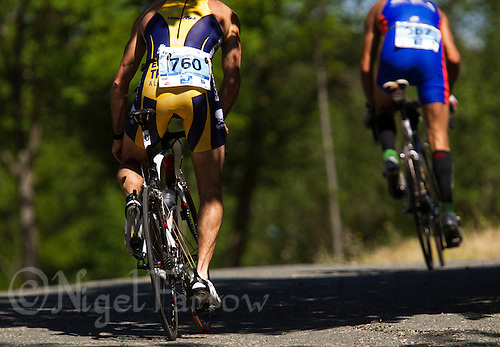 27 MAY 2012 - MADRID, ESP - Armando J Lechuga Arsuaga (Ecosport Triatlon Alcobe) (men 45-49) (left) follows Abel Reyes Cordero (A.D Sevilla Zambru's Bikes) (men 30-34) on the bike during the  Spanish Men's National Sprint Distance Championship qualifying race at Casa de Campo in Madrid, Spain .(PHOTO (C) 2012 NIGEL FARROW)