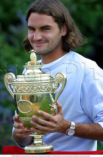 ROGER FEDERER of Switzerland with the trophy after winning the Mens Singles Title, 2003 Wimbledon Tennis Championships, 030706 Photo: Glyn Kirk/actionplus...2003 player players man.Grand Slam Grandslam.cup winner win