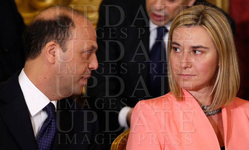 Il Ministro dell'Interno Angelino Alfano, a sinistra, ed il Ministro degli Esteri Federica Mogherini durante la cerimonia del giuramento del nuovo governo al Quirinale, Roma, 22 febbraio 2014.<br /> Italian Interior Minister Angelino Alfano, left, and Foreign Minister Federica Mogherini during the swearing in ceremony of the new government at the Quirinale presidential palace, Rome, 22 February 2014.<br /> UPDATE IMAGES PRESS/Riccardo De Luca