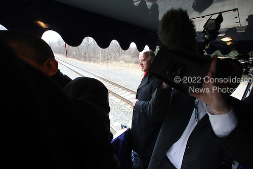 Edgewood, MD- January 17, 2009 -- United States Vice President-elect Joseph Biden during the second slow roll near Edgewood station, old Edgewood road off of US Rt. 40, Edgewood, Maryland on the way to Baltimore, Maryland, during Whistle Stop tour on Saturday, January 17, 2009. .Credit: Chang W. Lee - Pool via CNP