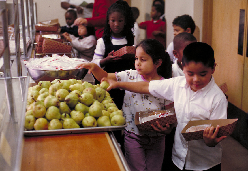 ELEMENTARY SCHOOL LUNCH LINE IN CAFETERIA. ELEMENTARY SCHOOL STUDENTS. OAKLAND CALIFORNIA USA CARL MUNCK ELEMENTARY SCHOOL.