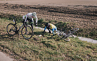 Michael Carbel (DEN/Fortuneo-Samsic) & Jelle Cant (BELTarteletto-Isorex) ending up in the frozen ditch next to the road.<br /> <br /> 50th GP Samyn 2018<br /> Quaregnon > Dour: 200km (BELGIUM)