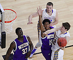 SIOUX FALLS, SD - MARCH 7: Keaton Moffitt #12 of South Dakota State tries a layup past Western Illinois defenders Dalan Antrum #15 and Jalen Chapman #33 during the first round of a men's Summit League Championship Tournament game Saturday evening at the Denny Sanford Premier Center in Sioux Falls, SD.  Ian Thiesen #42 of SDSU is in the background.  (Photo by Ty Carlson/Inertia)