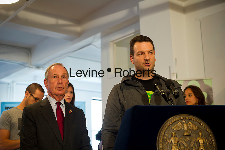 Boxee CEO Aver Ronen, right, speaks at a press conference during NY Mayor Mike Bloomberg's, left, visit to Boxee's Headquarters in the Chelsea neighborhood in New York, on Monday, October 1, 2012.  According to Mayor Bloomberg, the city is on track to create the most jobs this year since job tracking started 50 years ago. Boxee sells a software and hardware product that enables streaming of video from the internet onto your television. (© Frances M. Roberts)