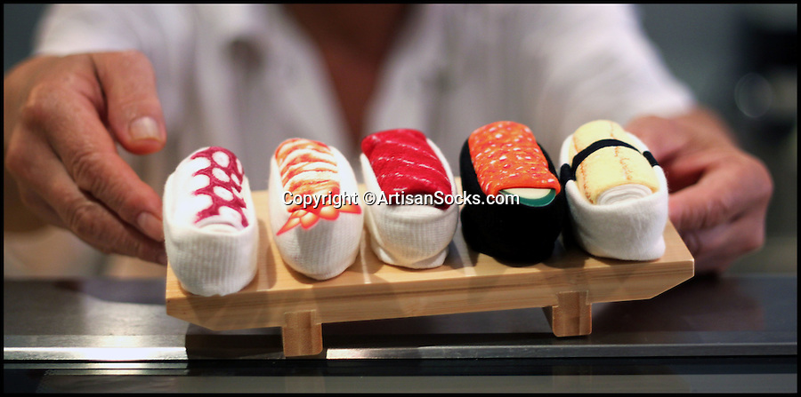 BNPS.co.uk (01202 558833)<br /> Pic: ArtisanSocks/BNPS<br /> <br /> ***Must Use Full Byline***<br /> <br /> A chef holds the sushi socks. <br /> <br /> Soft Sushi Shuffle...<br /> <br /> Now, should you wish to, you can make your sock draw look like a sushi bar.<br /> <br /> These morsels of mouthwatering sushi might look tantalising but you wouldn't want to eat them - because they're actually rolled up socks.<br /> <br /> The super-realistic items of clothing are the latest bizarre trend sweeping the fashion world and have been an instant hit with shoppers.<br /> <br /> Unrolled they look like any other sock but rolled up they form seven different varieties of the raw fish snack, transforming your underwear drawer into a smorgasbord of sushi.<br /> <br /> The life-like 'flavours' include egg (tamago), salmon roe (ikura), shrimp (ebi), octopus (tako), tuna (maguro ), salmon (sa-mon) and trout (masuzishi).<br /> <br /> Sushi socks cost $6 a pair - around £3.70 - and can be bought from artisansocks.com.