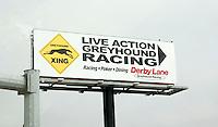 Greyhound racing billboard advertising Derby Lane along the freeway.  Tampa  Florida USA