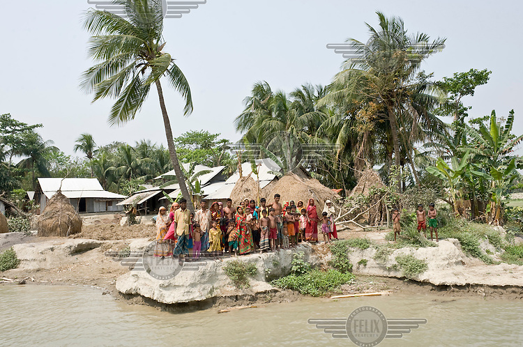 Villagers in the district of Patuakhali, which is part of an enormous delta in the south of Bangladesh. The region is known for its annual floods, which prevents necessary investment in the area. As water levels continue to rise, villagers will soon have to find another place to live.