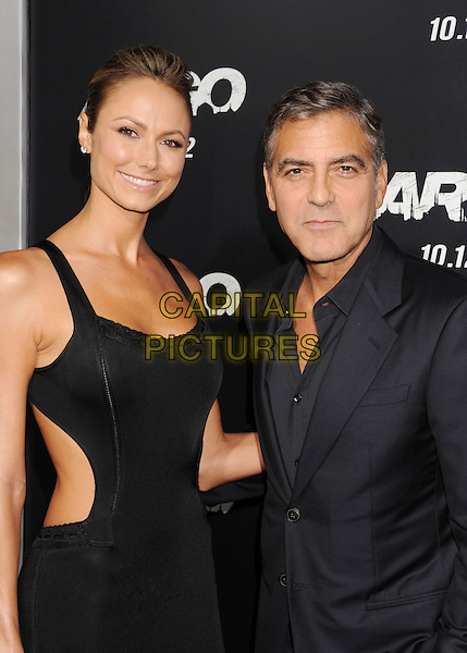Stacy Keibler & George Clooney.'Argo' Los Angeles premiere held at the AMPAS Samuel Goldwyn Theater, Beverly Hills, California USA,.4th October 2012..half length black dress sleeveless cut out sides away  couple suit .CAP/ROT/TM.© TM/Roth/Capital Pictures