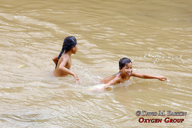 Girls Playing In River