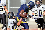 Santa Monica, CA 10/17/13 - unidentified Santa Monica player(s) and Alex Rosemond (Peninsula #11) in action during the Peninsula vs Santa Monica Junior Varsity football game at Santa Monica High School.