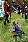 Girl playing air guitar. May Day Fair Glam Rock Band The Look the Perch and Pike pub South Stoke Berkshire UK 2006