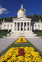 State House, State Capitol, Montpelier, Vermont, VT, State House grounds in Montpelier are decorated with red and yellow flowers.