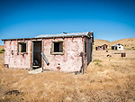Pink walls, windows & doors, ghost town of Beowawe, Nevada