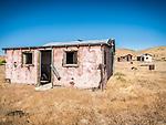 Pink walls, windows & doors, ghost town of Beowawe, Nevada