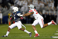 Ohio State Buckeyes linebacker Joshua Perry (37) grabs Penn State Nittany Lions wide receiver DaeSean Hamilton (5) during the first quarter of the NCAA Division I football game at Beaver Stadium in University Park, PA on October 25, 2014. (Columbus Dispatch photo by Jonathan Quilter)