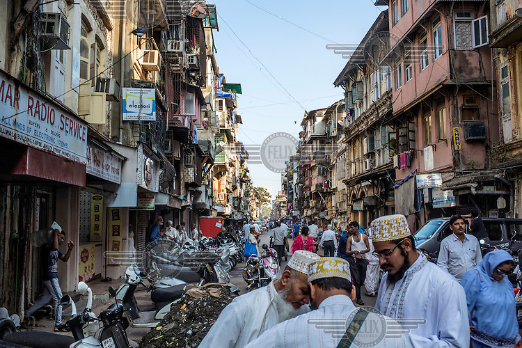 People in Bhendi Bazaar, an area populated mostly by Dawoodi Bohra, a Shia sect. Most of the property in the Bhendi Bazaar are decrepit colonial-era buildings that, while being intrinsic to the area's vibrancy, have not been maintained or modernised. The Saifee Burhani Upliftment Trust is in the process of buying up the area's buildings which are to be demolished and replaced with India's largest urban development. The former residents will be rehoused in bigger spaces within the new development. Although not without its critics, the project has been helped by the unity of the community and the perceived benefits they will gain from the development.