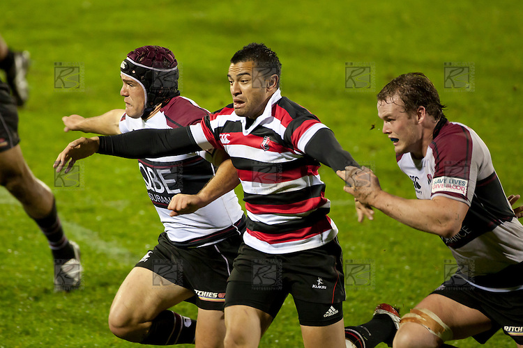 Sherwin Stowers chases a kick through with 2 North Harbour defenders. Counties Manukau Steelers pre season ITM Cup game against North Harbour played at Bayer Growers Stadium Pukekohe on Wednesday July 21st 2010..North Harbour won 22 - 21.