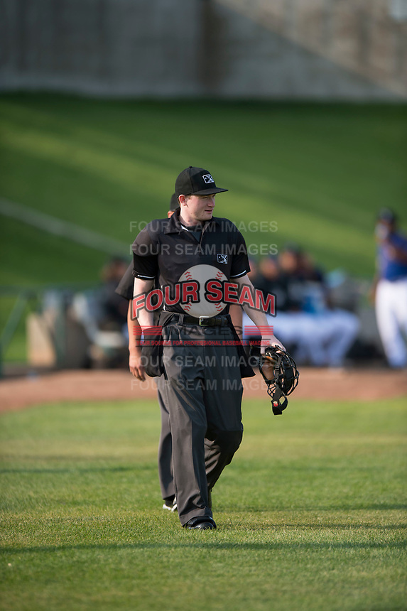 Home plate umpire Patrick Faerber walks onto the field before a Pioneer League game between the Missoula Osprey and the Grand Junction Rockies at Ogren Park Allegiance Field on August 21, 2018 in Missoula, Montana. The Missoula Osprey defeated the Grand Junction Rockies by a score of 2-1. (Zachary Lucy/Four Seam Images)