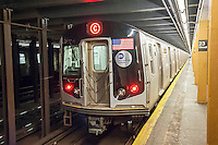 A spanking brand new R132 subway car departs the West 23rd Street station on the C line in New York on Friday, June 5, 2015. The new cars are replacing the 40 year old R32 cars whose air conditioning cannot keep up with hot air from trains' ventilation.  The older cars are the oldest rolling stock in the system. (© Richard B. Levine)