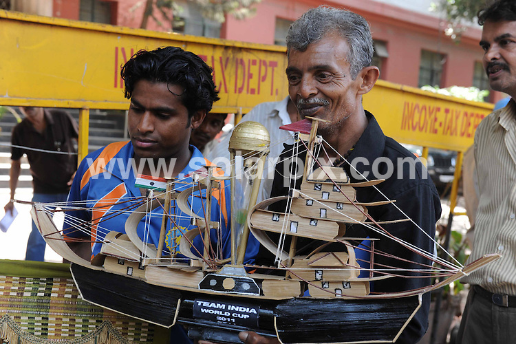 **ALL ROUND PICTURES FROM SOLARPIX.COM**                                             **WORLDWIDE SYNDICATION RIGHTS**                                                                                  Caption:  In a dramatic match, the Indian cricket team led by captain Mahendra Singh Dhoni clinched the tournament by six wickets at the Wankhede stadium in Mumbai to win the Cricket World Cup for only the second time having previously won it in London in 1983. .Throughout the land, people danced, let off fireworks and generally let themselves go as the tension of expectancy was released after the co-hosts had won cricket's greatest prize.                                                                             This pic: Atmosphere                                                                                      JOB REF: 13075 SJA       DATE: 03_04_2011                                                           **MUST CREDIT SOLARPIX.COM OR DOUBLE FEE WILL BE CHARGED**                                                                      **MUST AGREE FEE BEFORE ONLINE USAGE**                               **CALL US ON: +34 952 811 768 or LOW RATE FROM UK 0844 617 7637**