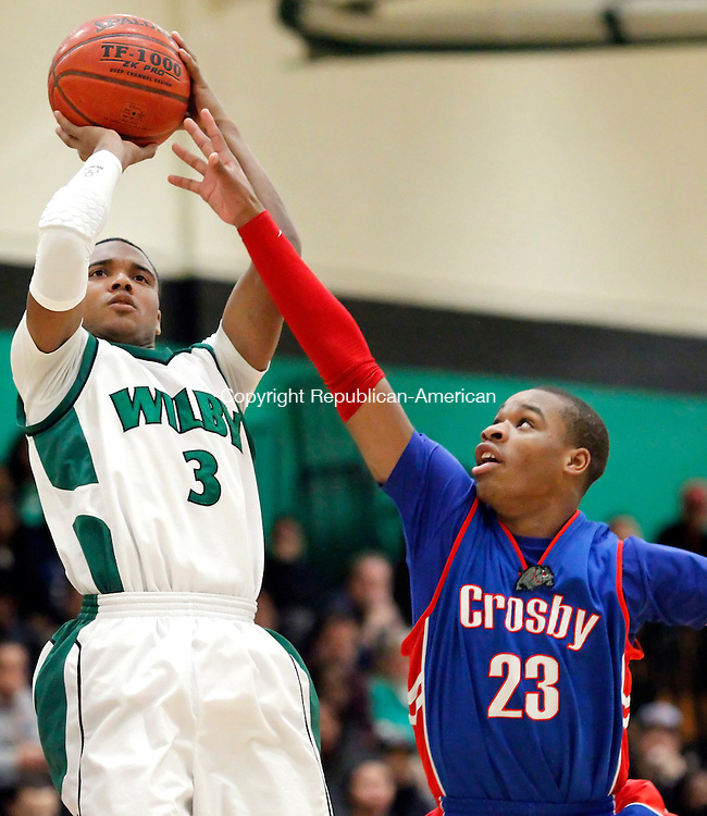 Waterbury, CT-03 February 2012-020312CM02-  Wilby's Tom King (3) shoots over Crosby's Tyshon Rogers during their NVL matchup in Waterbury Friday night.  Crosby won, 76-56.  Christopher Massa Republican-American