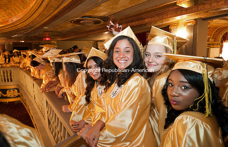 WATERBURY, CT-062014JS09--Kaynor Tech graduates wait for the start of graduation ceremonies Thursday at the Palace Theater in Waterbury. <br /> Jim Shannon Republican-American
