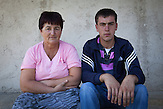 Lukavica Rijeka. Razija Aljić with her only remaining son Ruzmir (19). Following the return to their pre-war house in the village of Lukavica Rijeka, the family's tragedy took its course: In 1996 Razija lost Nedzad (19) in a landmine incident near their house. Only two years later her husband got killed in another explosion. In summer 2011 Razija's second son Yusuf and his brother-in-law were fatally wounded by a landmine explosion and died in the forests.
