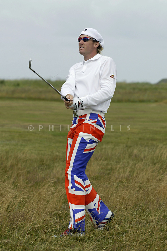 Ian POULTER (ENG) wearing union jack trousers, plays his approach shot to the 3rd green during the first round of the 133rd Open Championship played at the Royal Troon Golf Club on 15th July 2004 in Troon, Scotland. Picture Credit / Phil Inglis